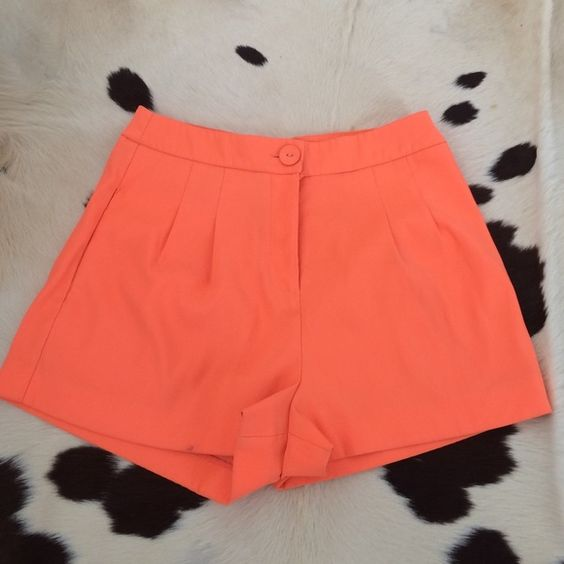 NEON HIGH WAISTED HIGHLIGHTER SHORTS  Adorable pair of neon colored high waisted shorts. Pockets and button enclosure. Small nail polish stain on bottom right hem. So cute on! Forever 21 Shorts