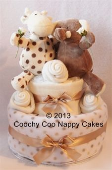 Unisex Elli the elephant and Raff the giraffe nappy cake baby gift. Great neutral baby gift idea for a baby shower and great for a twins gift too. £50.00 www.coochycoonappycakes.co.uk