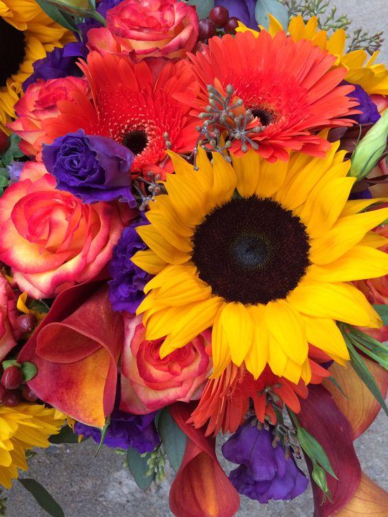 Bridal bouquet sunflowers, circus roses, mango callas, purple list thus seeded eucalyptus, orange gerber Daisha