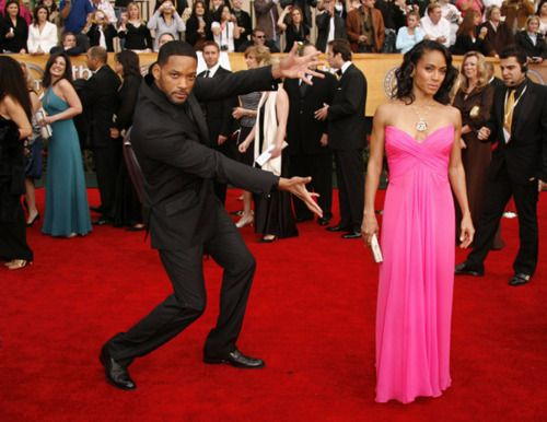 Most men just stand next to their date and hold their hand or something...and then there's Will Smith. lol