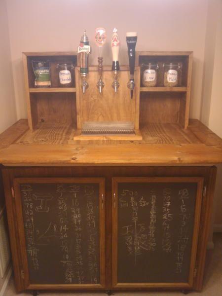 Homemade kegerator with built in chalkboard storage doors.