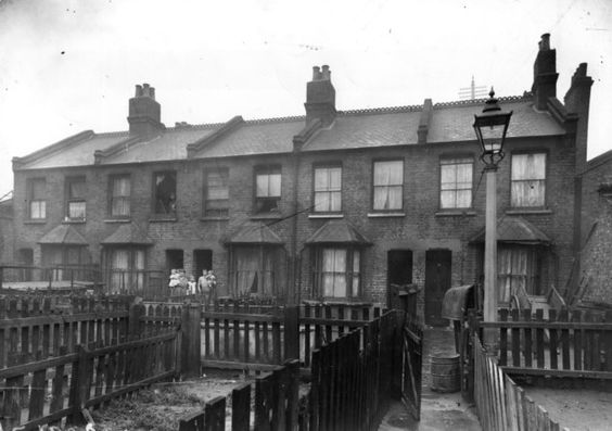 1923: The exterior of houses in a slum area in Bethnal Green (Photo by Topical Press Agency/Getty Images)