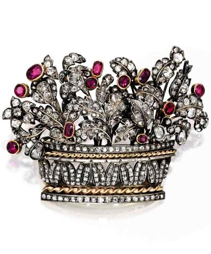 Silver, gold, diamond and ruby brooch. Designed as a floral arrangement set with numerous old mine-cut diamonds, accented by round, oval and cushion-cut rubies, mid 19th century.