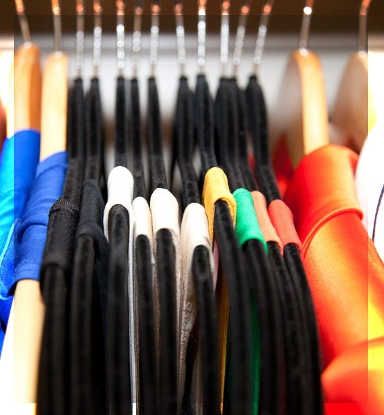 Only Use 1 or 2 Styles of Coat Hangers.  Slim Velvet Hangers prevent clothes from falling off & they are dainty. Save big thick wooden hangers for heavier items like coats, blazers and jackets.