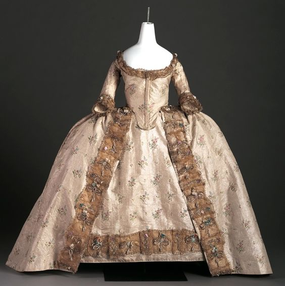 Court Gown, c. 1760 Silver tissue woven with multi-colored foil flowers and trimmed with gold lace European 1979.c.482.A-B