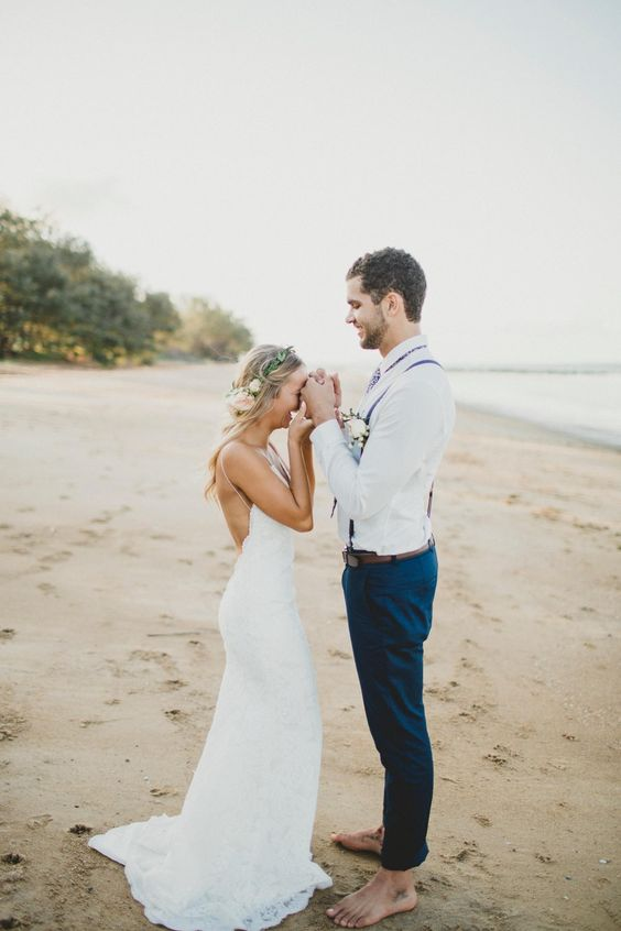 The bride and groom share a moment of laughter on their wedding day. What is love without laughter after all? Jasmine's glowing in Katie May's backless Poipu Wedding Gown.