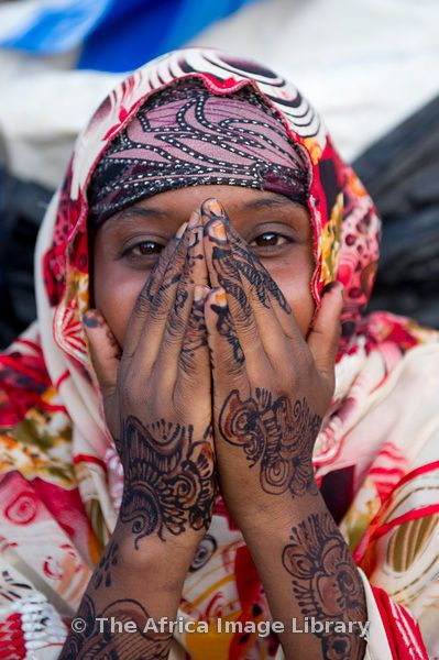 Girl with hennaed hands -- Hargeisa, Somali-land, Somalia