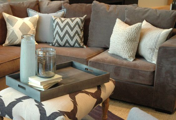 Grey Suede Couch With White And Chevron Accent Pillows