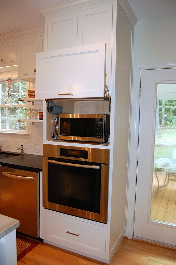 Hidden microwave above wall oven unit kitchen design by for Kitchen designs microwave