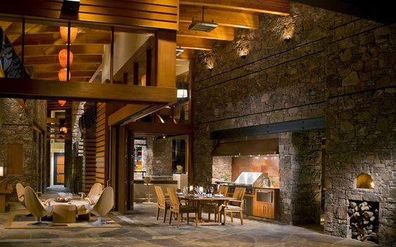 Ed: Love this - blend of indoor and outdoor space. Seems ancient, yet modern. Great use of materials, texture and lighting!  The owners spent 3½ years building this mountain home using rock found mostly on site.The husband says there is more than 50,000 square feet of stone work, including retaining walls and six outdoor living areas.