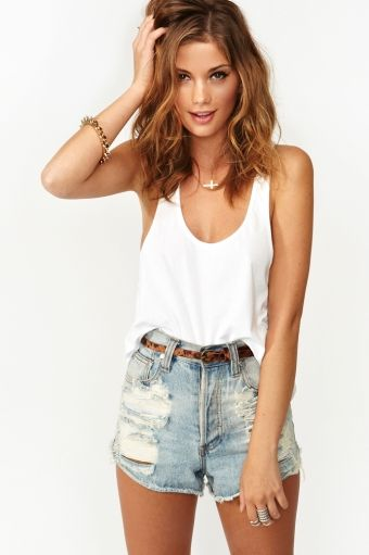 Loose white tank tucked into high waisted light blue jean shorts ...