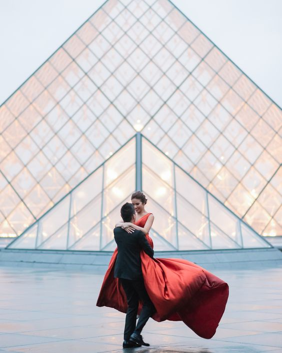 We call this the whimsical twirl! #parisphotographer #parisengagement #eiffeltower www.theparisphotographer.com