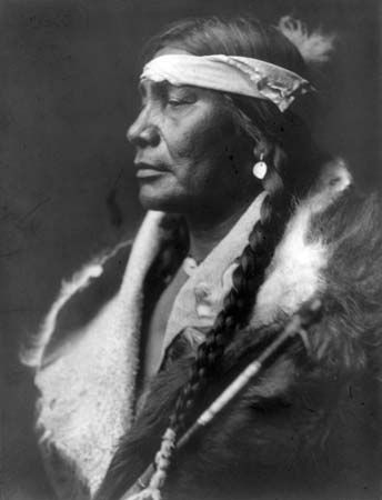 """Atsina man. Atsina, also called Gros Ventres of the Prairie, self-name A'aninin , North American Indian tribe related to the Algonquian-speaking Arapaho, from which they may have separated as early as 1700. The variant name Gros Ventres (French: """"Big Bellies"""") was a misinterpretation by French trappers of Plains Indian sign language. The Blackfoot called the Atsina the """"Belly People,"""" and the sign for that name was similar to one referring to the chest tattooing practiced by a neighbouring…"""
