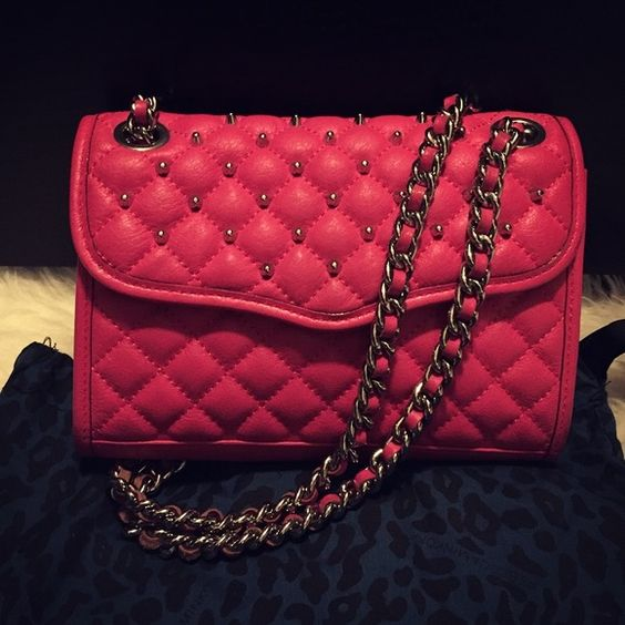 RB hot pink quilted mini Rebecca Minkoff hot pink quilted mini love affair. Perfect pop of color and statement bag for a party and ladies night out! Comes with dust bag and original price tag. Used with love. Has some soft stains in the bottom back from rubbing on my dark clothes wearing out but bag is in really good condition! Rebecca Minkoff Bags