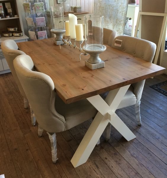 X-frame dining table with linen button back chairs ~ from www.countrylifeinteriors.co.uk