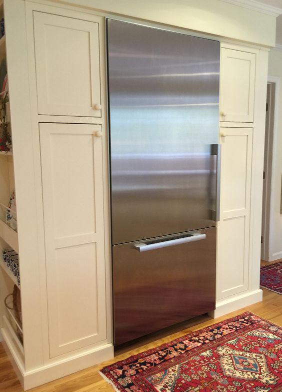 yellow kitchen - built in Miele 36 inch bottom freezer refrigerator in the…