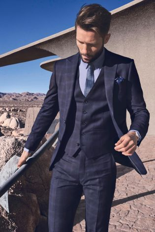 Hold up there! This season's suiting selection is jam packed full of on-point tailoring, but our Navy Signature Check Suit is next level sharp...: