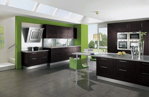 black cabinets with green accents. flat cabinets with skinny round silver handles and stainless steel appliances