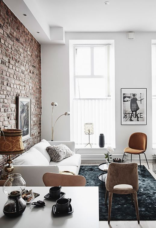 Contrast The Rug Proves Color Contrast To The Rest Of The Light Room And The Exposed Brick Wall Pr Brick Living Room Apartment Interior Brick Wall Living Room