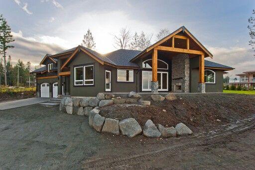 Dark grey siding with cedar beams and accents grey rock for Rock and cedar homes