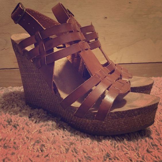 Mia brown leather platform with a woven wedge. Brown leather platform with woven wedge. Size 7 worn twice. MIA Shoes Wedges