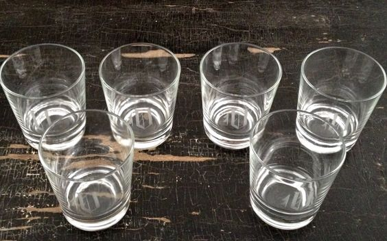 "Vintage set of six etched varsity glasses. 3""w x 3.5""h"