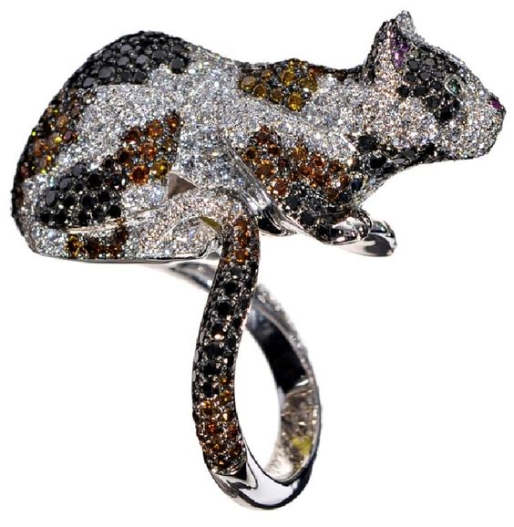 Chopard cat ring, in white gold set with white, yellow, brown and black diamonds. Two, please.