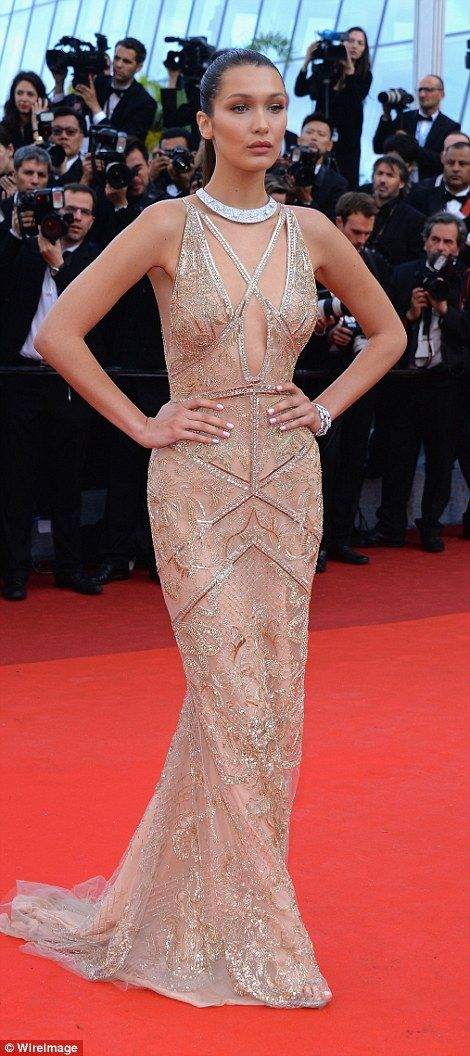 Oozing glamour: Bella looked sensational in glamorous nude gown as she wowed on the red ca...: