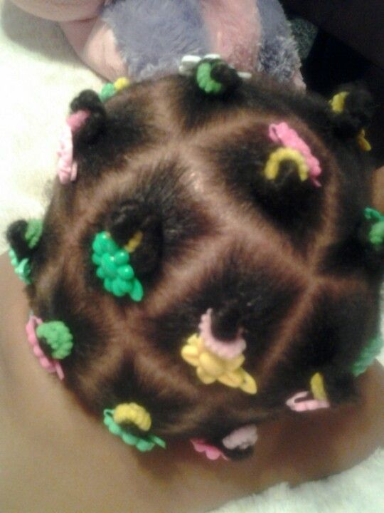 "Toddler ""Bantu knots"":"
