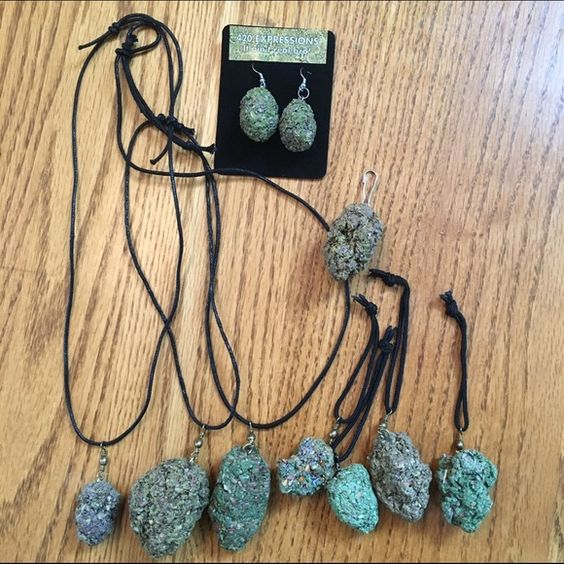 420 Special! 420 Expressions marijuana faux accessories! I have everything shown in the photos above: 1 pair earrings, 4 small Keychains, 1 small clip keychain, 3 large adjustable necklaces, and 50 pins! 420 Expressions Accessories
