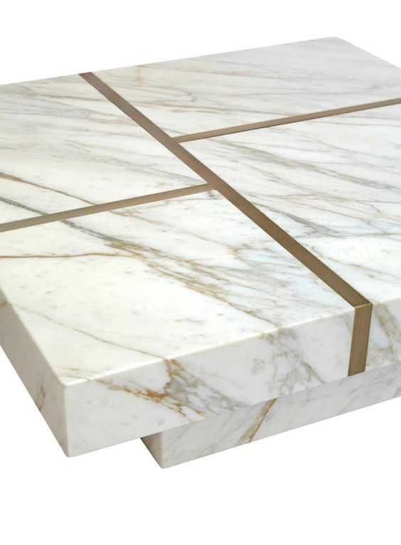 Handmade coffee table designed by Two Is Company. Marble with oxidized brass linear pattern, model