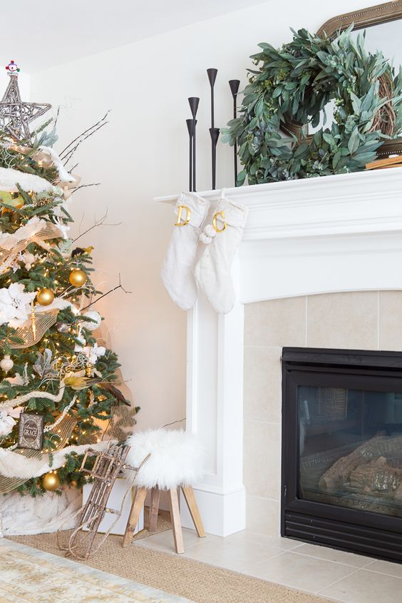 Cream and gold Christmas in a neutral living room. Fur accents make it so cozy!: