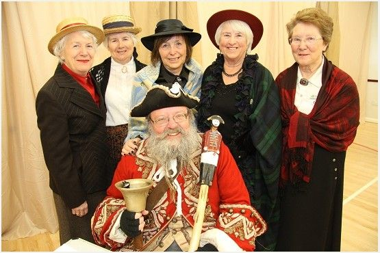 Members of the WImborne Evening Wi with Wimborne Town Crier Chris Brown