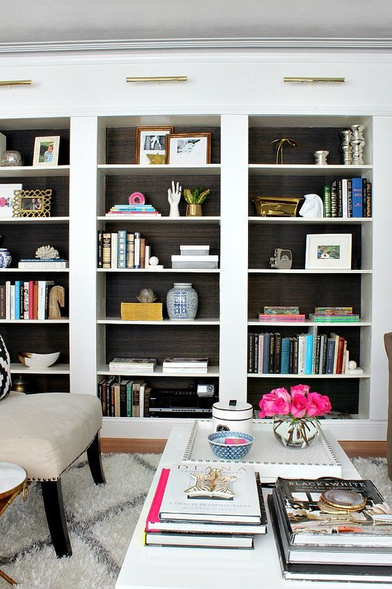 Grasscloth backed bookcases.  Easy DIY project you can do in a few hours for a huge impact that adds major style and depth.: