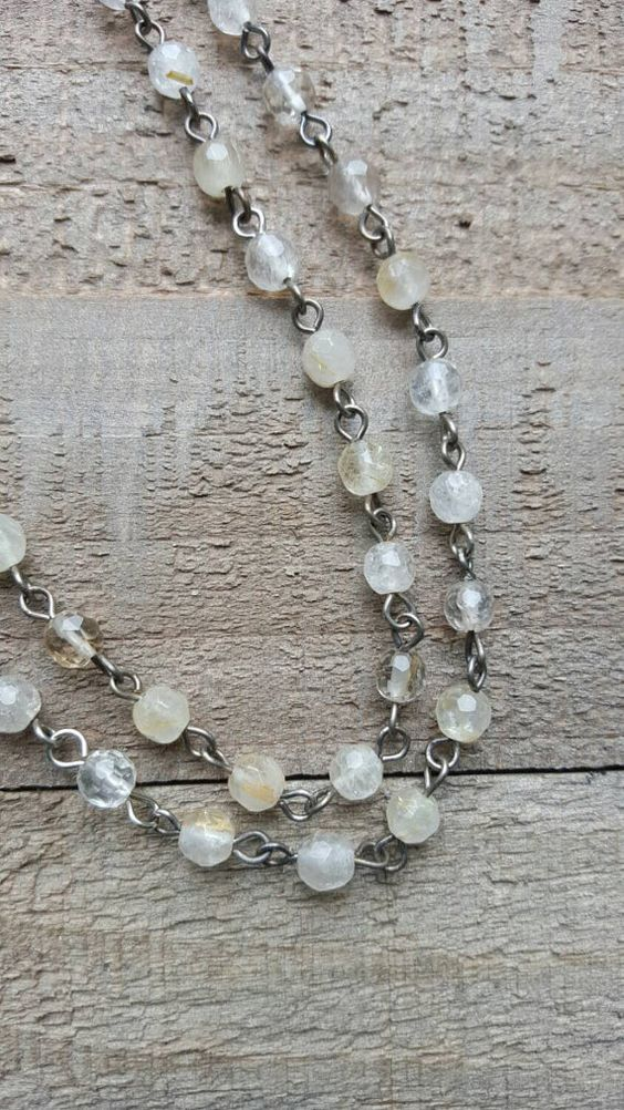 Check out this item in my Etsy shop https://www.etsy.com/listing/166184581/silvertone-double-quartz-bead-necklace