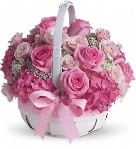 Pink hydrangea, roses and spray roses along with Queen Anne's lace.  For girly-girls of all ages: