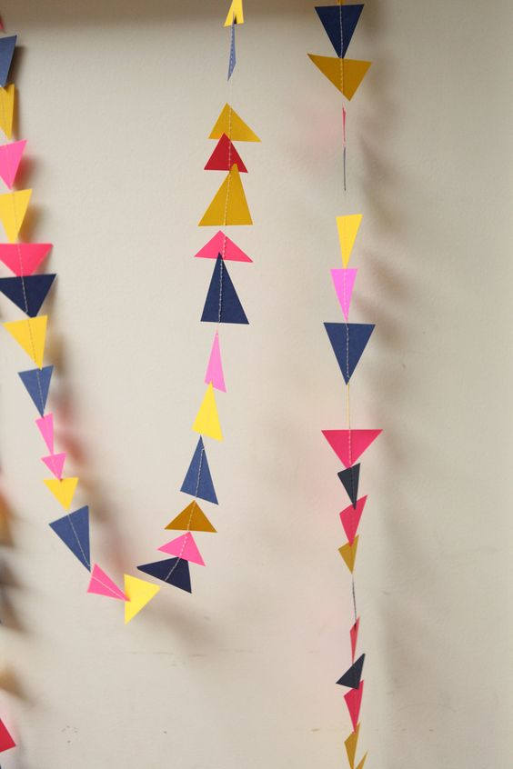 neon pink, navy blue and yellow triangle garland - 10 feet. $12.00, via Etsy | chiarabelle