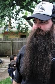 Men should have well-groomed facial hair before going into an interview.  Shave that lengthy beard!