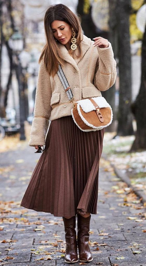 what to wear with a nude fur jacket : crossbody bag   brown midi skirt   boots