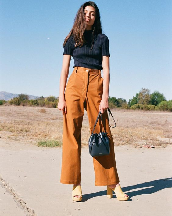 Cropped flared pant with chunky heels.