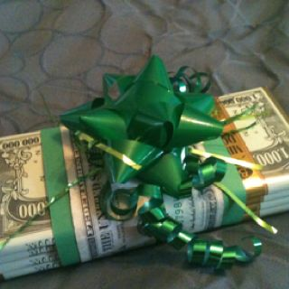 How to wrap money for kids day gift!  Just get some money candy bars from the dollar tree, hide the money in between and hold together with a dollar bill & some ribbon.