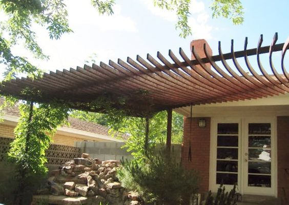 Custom residential steel awning shade structure.