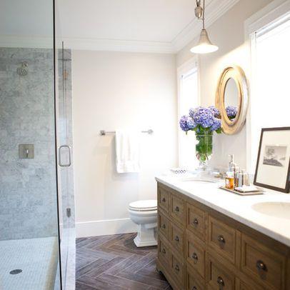 master bath: wood vanity, slate herringbone floor, marble shower, gold-framed mirrors, industrial light fixture