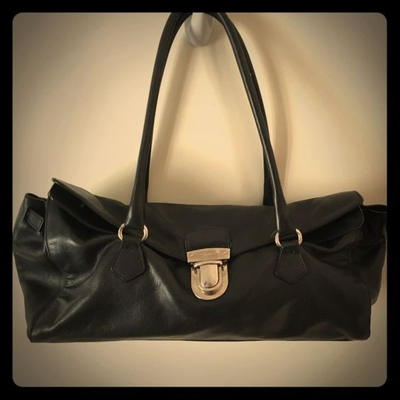 Authentic Black Prada Handbag This classic and chic authentic Prada handbag will always be in style! In excellent to very good condition overall (just needs a cleaning). A great deal for a Prada bag! Bottom measures approximately 14 in x 4 in and is approximately 6 in tall when closed. Prada Bags Shoulder Bags