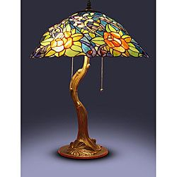 Add a classic touch to your home decor with this Tiffany style lampTable lamp features a rose tree motif Light has a stained glass shade