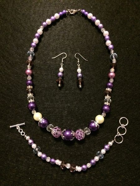 The Charlotte Collection of Purple pearl strands features a variety of pearl sizes and in combination with the Lilac Spectra beads, adds a colorful spin on a classic pearl design.