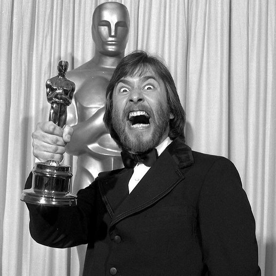 "This is Rick Baker holding up his Oscar for Makeup in 1982 for his work on ""An American Werewolf in London"". What is your favorite use of makeup in a movie? by theacademy:"