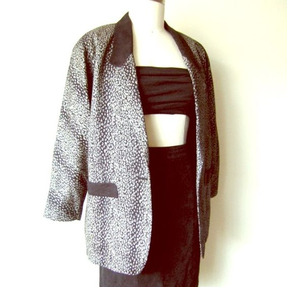 """Vintage Leopard Print Blazer Jacket This cool Asian 80s Vintage oversized blazer has a unique silver leopard print allover with black jacquard lapel and pocket details.   Wonderfully constructed and fully lined, this awesome piece is sure to wow and give a punch to any outfit.    Size: M  MEASUREMENTS:   LENGTH:  31"""" /  78.5CM  BUST:   44"""" /  112CM   WAIST: 42"""" / 106CM  HIPS: 40"""" / 101.5CM  SHOULDERS: free  SLEEVE: 22""""/ 56CM Jackets & Coats Blazers"""