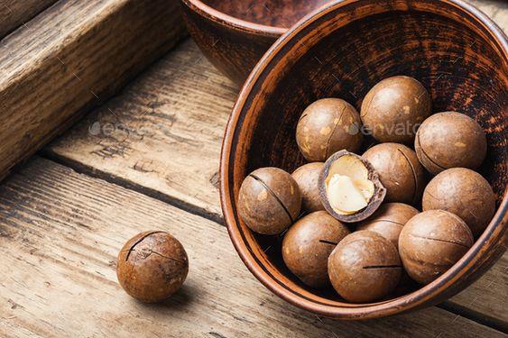 Shelled macadamia nuts by Nikolaydonetsk. Organic macadamia nut on old wooden table.Heap of macadamia nuts #AD #nuts, #Nikolaydonetsk, #Shelled, #macadamia
