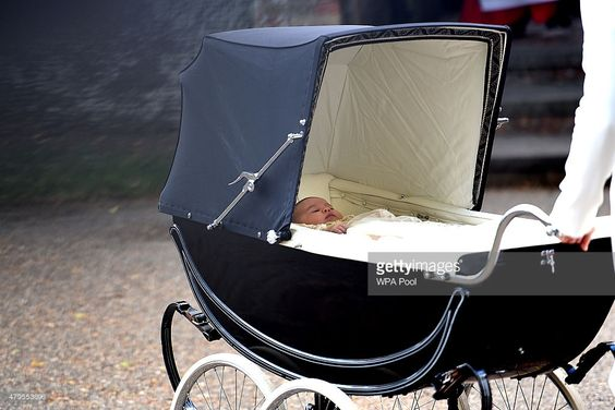 --July 05, 2015- Christening--Catherine, Duchess of Cambridge pushes in a pram Princess Charlotte of Cambridge as they arrive at the Church of St Mary Magdalene on the Sandringham Estate for the Christening of Princess Charlotte of Cambridge on July 5, 2015 in King's Lynn, England.
